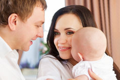 Happy smiling family with little baby girl Stock Image