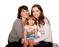 Happy smiling family, mother and two daughters Stock Photos