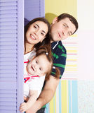 Happy smiling family with one year old baby girl Stock Photography