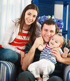 Happy smiling family with one year old baby Stock Photography