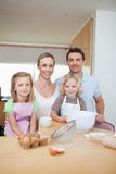 Happy smiling family preparing cookies. Together stock image