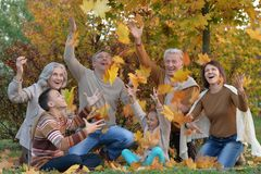 Family relaxing in autumn park stock image