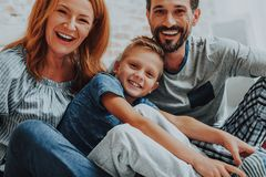 Happy smiling family relaxing together at home royalty free stock photography