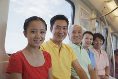 Happy smiling family sitting in the subway, portrait Stock Photography