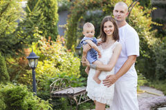 Happy smiling family of slim fit beautiful brunette mother, bold Royalty Free Stock Photos