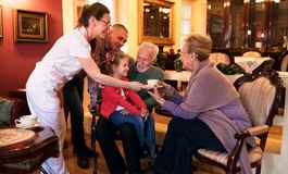 Family visit grandparents at nursing home. Happy smiling family visit grandparents at nursing home Stock Photos