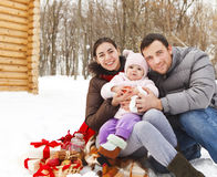 Happy smiling family with at the winter picnic Royalty Free Stock Images