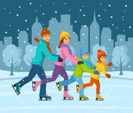 Happy smiling family, woman, man, boy and girl ice skating together on ice rink having fun Stock Photo