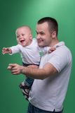 Happy smiling father embracing his baby boy Royalty Free Stock Photography