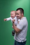Happy smiling father embracing his baby boy Stock Images