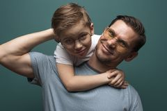 Happy smiling father and his little kid royalty free stock images