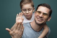 Happy smiling father and his little kid stock photo