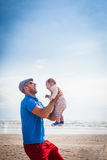 Happy smiling father holding baby Royalty Free Stock Photography