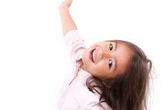 Happy, smiling female asian caucasian kid playing Stock Photo