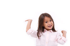 Happy, smiling female asian caucasian kid playing. White isolated background Royalty Free Stock Photo