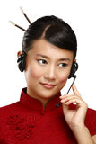 Happy smiling female asian customer service operator. On white Royalty Free Stock Photo