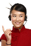 Happy smiling female asian customer service operator. On white Stock Photo