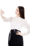 Happy smiling female in black skirt and white shirt uniform taki Stock Photography