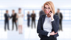 Happy smiling female business manager talking on the phone Stock Image