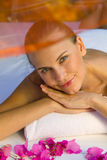 Happy smiling female enjoys in spa. Royalty Free Stock Images