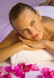 Happy smiling female enjoys in spa. Stock Photography