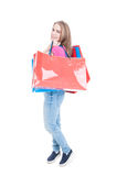 Happy smiling female holding colored shopping bags Stock Image