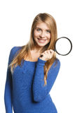 Woman standing with magnifying glass Royalty Free Stock Image