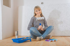 Happy smiling female painter sitting Royalty Free Stock Photography
