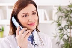 Happy smiling female patient doctor provides consultation to her Royalty Free Stock Photos