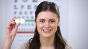Happy smiling female patient showing case with contact lens, recommendation. Stock footage stock video