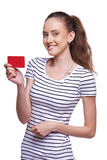 Happy smiling female showing blank credit card Stock Photo