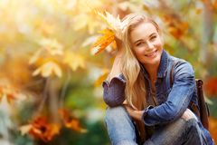 Happy female in autumn forest Royalty Free Stock Photos