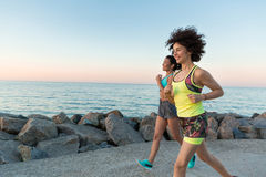 Happy smiling fitness women jogging together Royalty Free Stock Photo