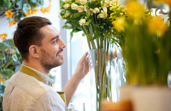 Happy smiling florist man at flower shop Royalty Free Stock Photos
