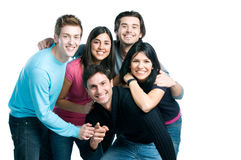 Happy smiling friends have fun together. Happy smiling group of young friends standing and embracing together isolated on white background with copy space Stock Image