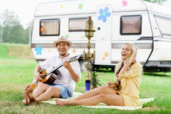 Happy, smiling friends having a picnic outdoors. Stock Image