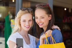 Happy smiling friends looking at smartphone Royalty Free Stock Images