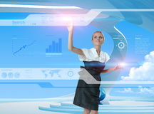 Happy smiling future girl. Happy blonde using technologies of the future Stock Image