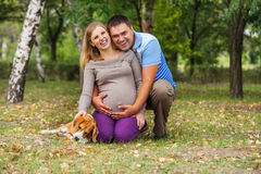 Happy smiling future parents on the walk Royalty Free Stock Photo
