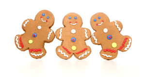Happy Smiling Gingerbread Figures on White Royalty Free Stock Photos