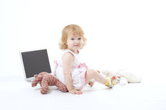 Happy smiling girl. With her computer Royalty Free Stock Image