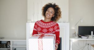 Happy Smiling Girl With Afro Haircut Holding Gift stock video