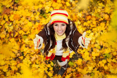 Happy smiling girl in autumn park stock image