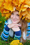 Happy smiling girl in autumn park, top view Stock Photos