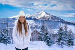 Happy smiling girl in beautiful Colorado mountain town. Happy smiling girl in the mountains. Girl enjoying beautiful Colorado mountain town on winter break stock images