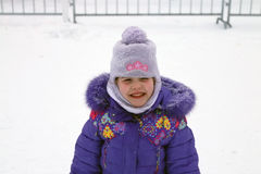 Happy smiling girl in blue jacket Royalty Free Stock Photos