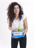 Happy smiling girl with books and apple Stock Photo