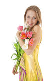 Happy smiling  girl with a bouquet of spring tulips. Royalty Free Stock Image