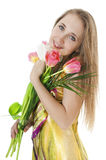 Happy smiling  girl with a bouquet of spring tulips. Stock Photography