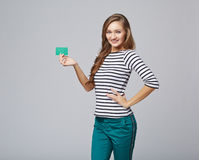 Happy smiling girl in casual clothing, showing blank credit card Stock Photography